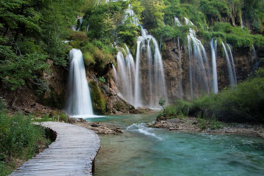 """Croatia: Plitvice Lakes National Park""""The waters flowing over the limestone and chalk have, over thousands of  years, deposited travertine barriers, creating natural dams which in  turn have created a series of beautiful lakes, caves and waterfalls.  These geological processes continue today. The forests in the park are  home to bears, wolves and many rare bird species."""" — UNESCO Photo: I√ɬ±igo Fdz De Pinedo, Getty Images/Flickr RF / Flickr RF"""