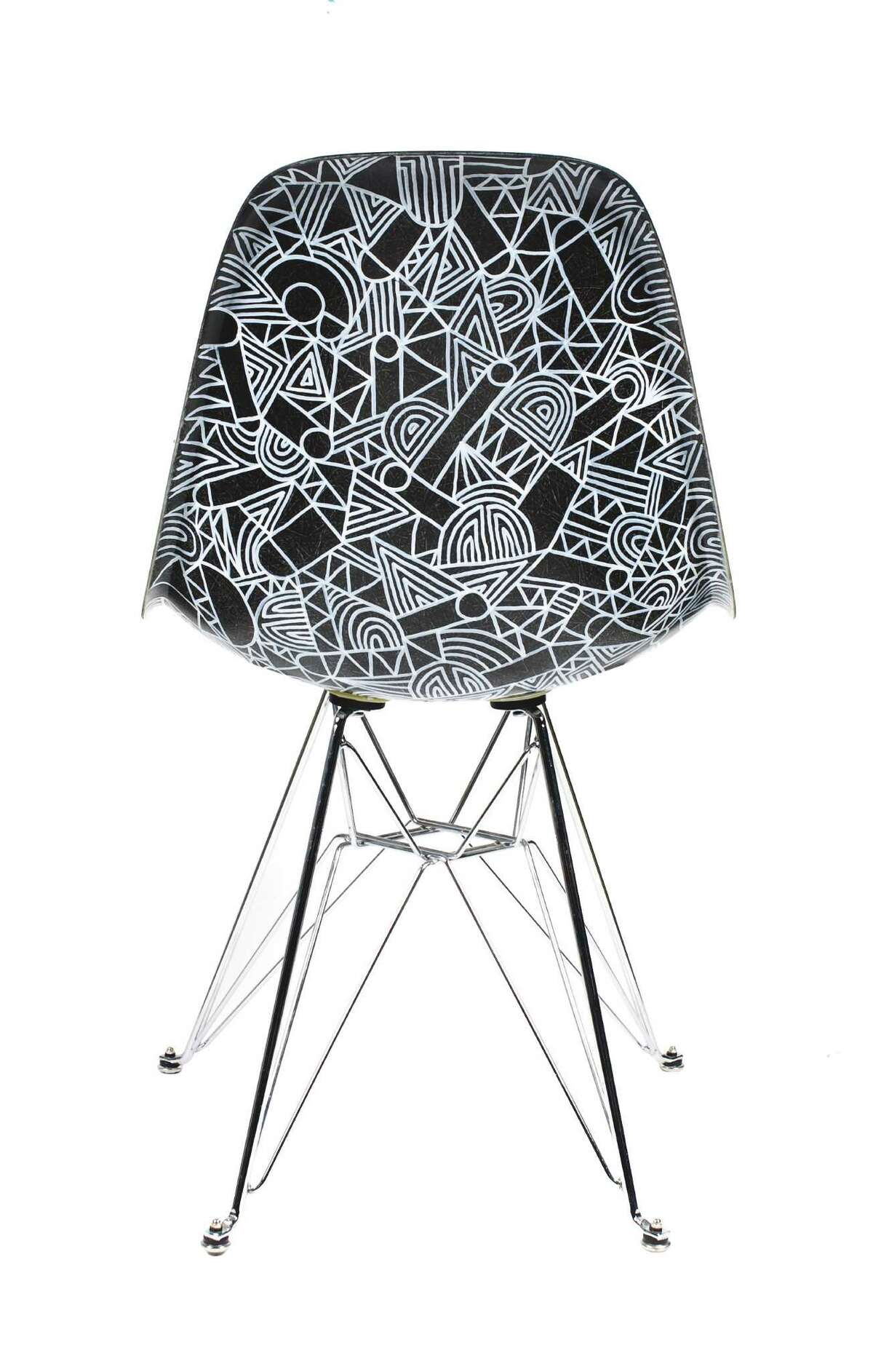 """The back of Mike Perry's """"Eames Eiffel Side Chair"""" is hand painted."""