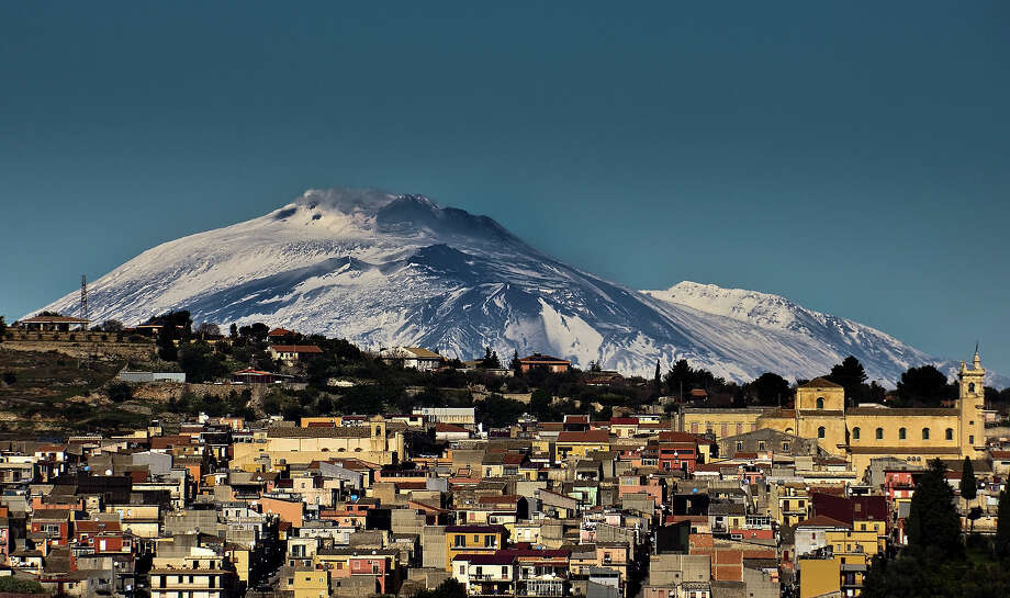 """Italy: Mount Etna""""Mount Etnais an iconic site encompassing 19,237 uninhabited hectares on  the highest part of Mount Etna, on the eastern coast of Sicily. Mount  Etna is the highest Mediterranean island mountain and the most active  stratovolcano in the world. The eruptive history of the volcano can be  traced back 500,000 years and at least 2,700 years of this activity has  been documented. The almost continuous eruptive activity of Mount Etna  continues to influence volcanology, geophysics and other Earth science  disciplines. The volcano also supports important terrestrial ecosystems  including endemic flora and fauna and its activity makes it a natural  laboratory for the study of ecological and biological processes. The  diverse and accessible range of volcanic features such as summit  craters, cinder cones, lava flows and the Valle de Bove depression have  made the site a prime destination for research and education."""" — UNESCO Photo: Foto Pietro Columba, Getty Images/Flickr RF / Flickr RF"""