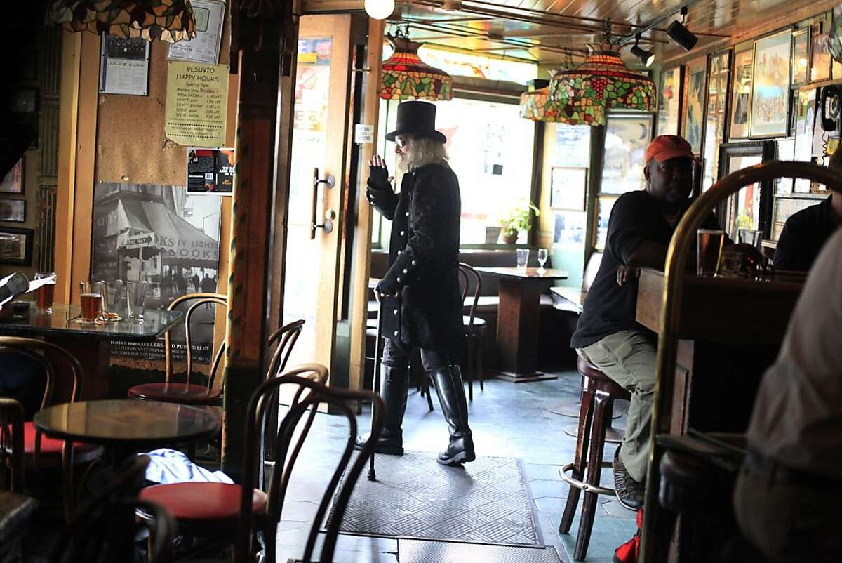 """Before the evening crowds show, Patrick """"Captain Cool"""" LeBold makes his exit at Vesuvio Cafe in North Beach."""