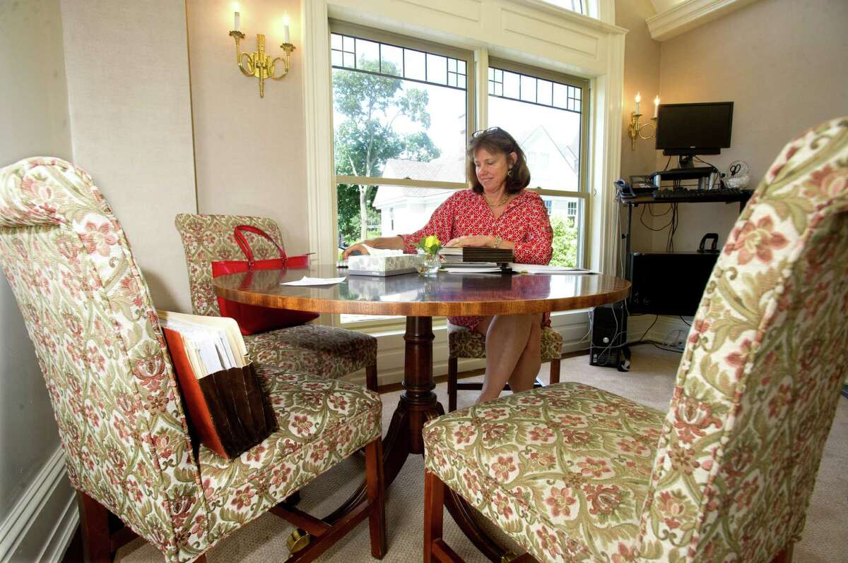 Amy Wilfert, Managing Partner of the Greenwich office of Day Pitney, works in the firm's new office space at 24 Field Point Road in Greenwich, Conn., on Friday, August 2, 2013.