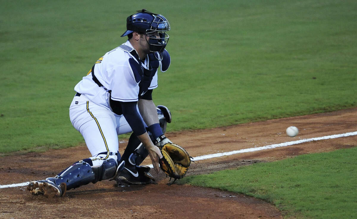Montgomery Biscuits catcher Curt Casali takes a throw to home against the Jacksonville Suns in the first game of a double header at Riverwalk Stadium in Montgomery, Ala. on Thursday July 25, 2013. (Mickey Welsh, Montgomery Advertiser)