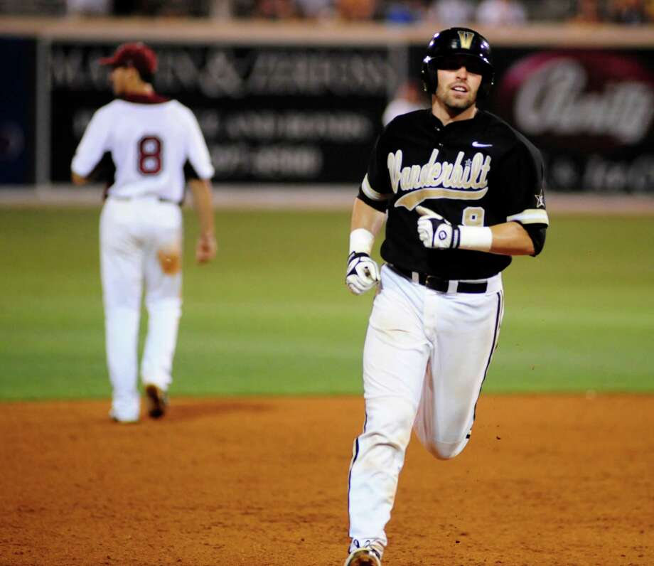 Vanderbilt's Curt Casali rounds the bases after hitting a home run against Troy during an NCAA regional college baseball tournament game won by Vanderbilt 10-2, Saturday, June 4, 2011, in Nashville, Tenn. (AP Photo/Mike Strasinger) Photo: Mike Strasinger, ASSOCIATED PRESS / AP2011