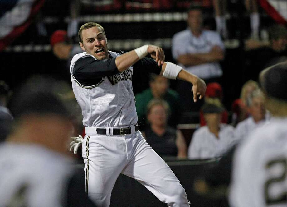 Vanderbilt's Curt Casali leaps after scoring the winning run in the bottom of the 10th inning of an NCAA college baseball  tournament regional game against Louisville in Louisville, Ky., Monday, June 7, 2010. Vanderbilt won 3-2. (AP Photo/Ed Reinke) Photo: Ed Reinke, ASSOCIATED PRESS / AP2010