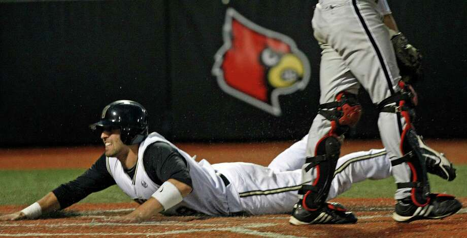 Vanderbilt's Curt Casali slides across home to score the winning run in the bottom of the tenth inning of their NCAA college baseball tournament regional game against Louisville in Louisville, Ky., Monday, June 7, 2010. (AP Photo/Ed Reinke) Photo: Ed Reinke, ASSOCIATED PRESS / AP2010