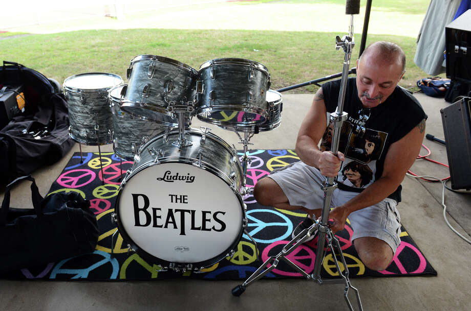 Drummer Vinnie Castellano with the Beatles tribute band Beatles Forever, sets up his kit for an evening concert under the Milford Pavilion behind the library in downtown Milford, Conn. on Friday August 2, 2013. Photo: Christian Abraham / Connecticut Post
