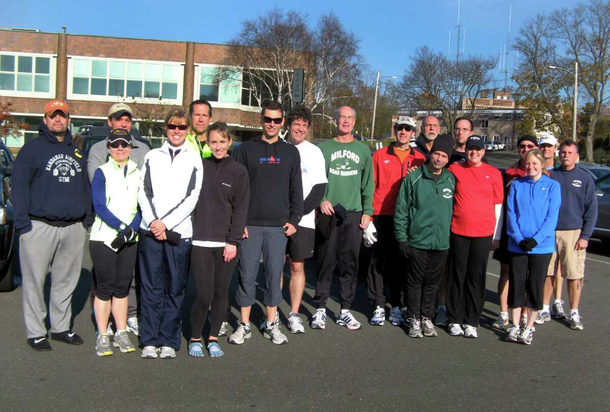 Members of the Milford Road Runners pose for a picture prior to a run. The club, which was formed in 1978, provides a forum for runners of all abilities to train, compete and socialize.
