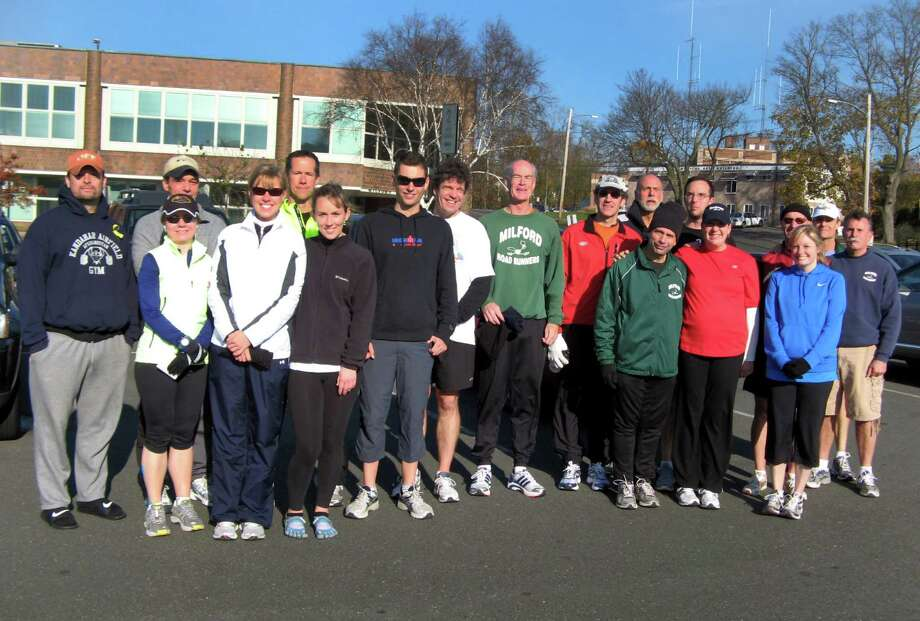 Members of the Milford Road Runners pose for a picture prior to a run. The club, which was formed in 1978, provides a forum for runners of all abilities to train, compete and socialize. Photo: Contributed Photo / Connecticut Post Contributed