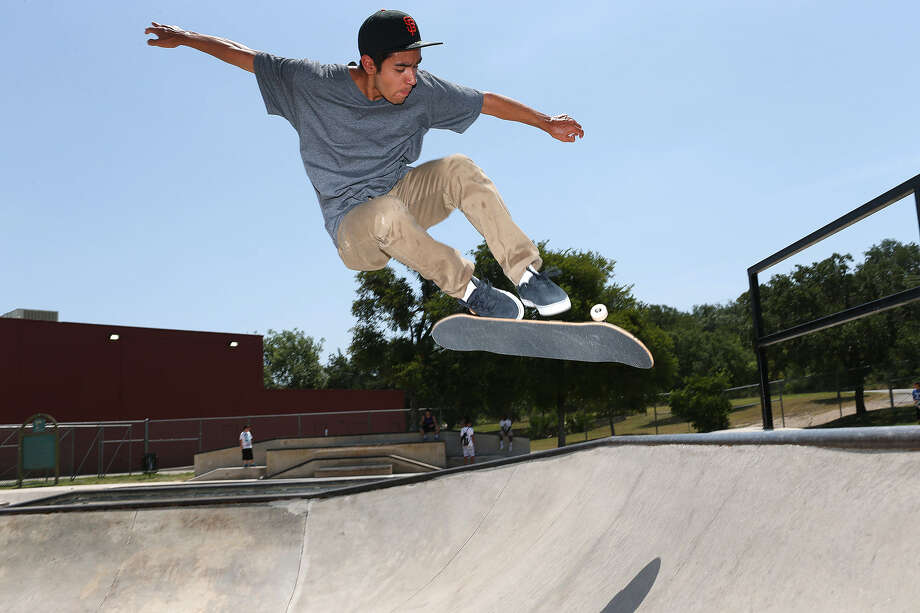Will Flores demonstrates his moves while skateboarding at LBJ Skatepark in preparation for competing at the 2013 X Games in Los Angeles. Photo: Jerry Lara, San Antonio Express-News