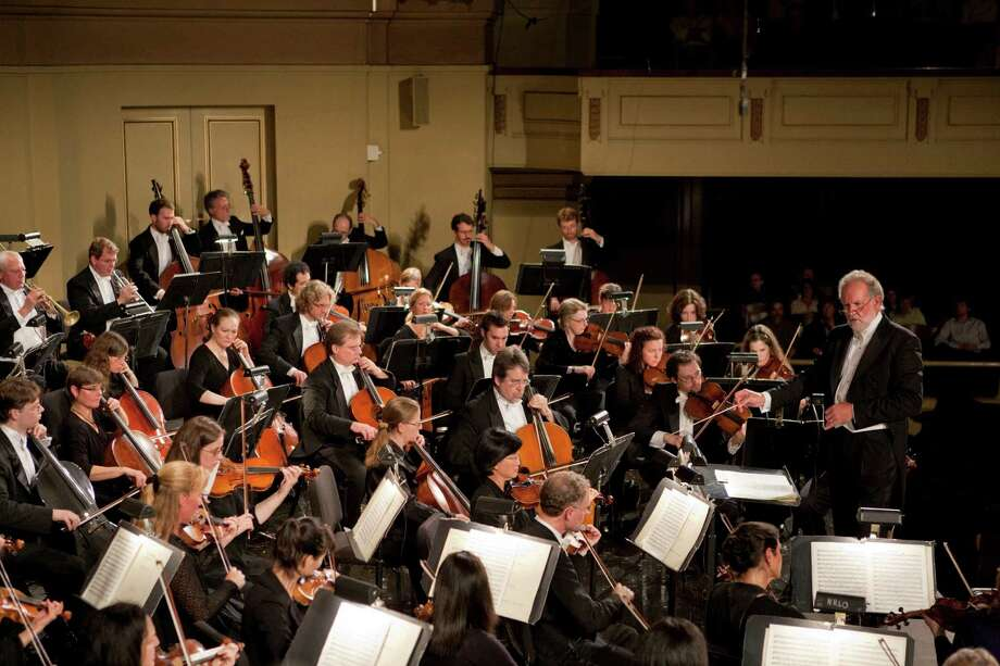 The New Haven Symphony Orchestra will present 10 concerts in Fairfield County next season, which includes a pops concert series and a family series in Shelton. At right is Music Director William Boughton, shown on the podium at Woolsey Hall. Photo: Contributed Photo / Connecticut Post Contributed