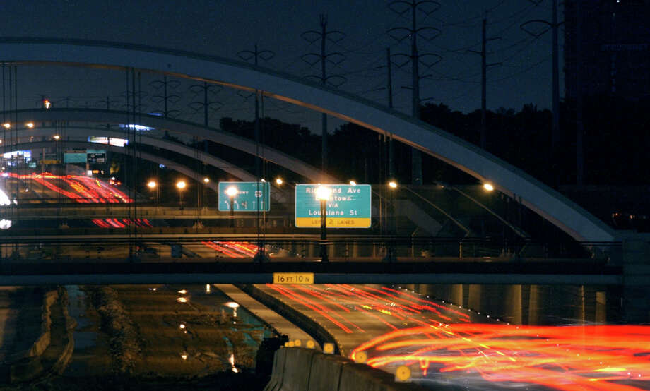The new lights on the arched bridges on Mandell, Woodhead, Dunleavy and Hazard luminate the streets Thursday, July 18, 2002  CHRISTOBAL PEREZ/HOUSTON CHRONICLE Photo: Christobal Perez, Staff / houston chronicle