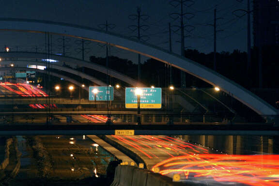 The new lights on the arched bridges on Mandell, Woodhead, Dunleavy and Hazard luminate the streets Thursday, July 18, 2002  CHRISTOBAL PEREZ/HOUSTON CHRONICLE