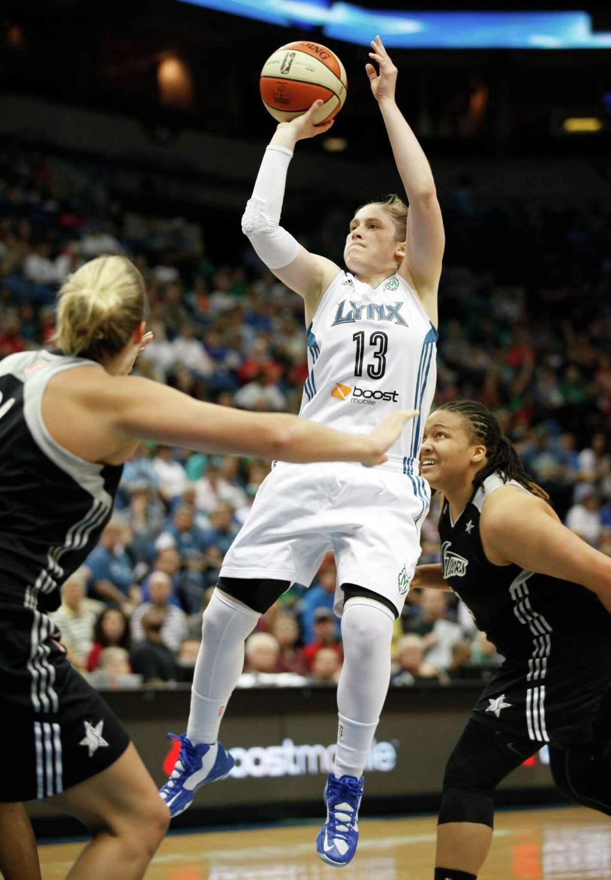 Minnesota Lynx guard Lindsay Whalen (13) goes up for a shot against San Antonio Silver Stars center Jayne Appel, left, in the first half of a WNBA basketball game, Friday, August 2, 2013, in Minneapolis. (AP Photo/Stacy Bengs)