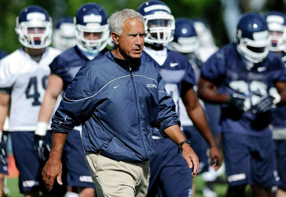 Connecticut head coach Paul Pasqualoni walks with his team during NCAA college football practice in Storrs, Conn., Friday, Aug. 2, 2013. Photo: Jessica Hill, AP / Associated Press