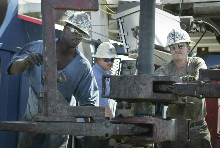 A crew drills a gas well in the Barnett Shale south of Weatherford. Research by the University of Texas at Arlington indicates that water wells closer to the fracking have elevated levels of arsenic. Photo: Fort Worth Star Telegram File Photo