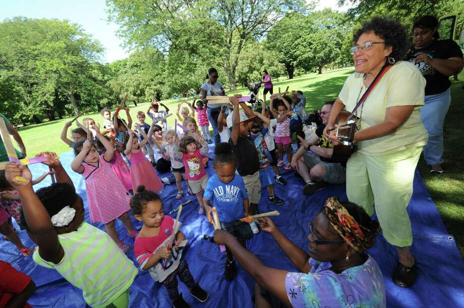 Ruth Pelham of the Music Mobile, right, performs for daycare children Friday Aug. 2, 2013, at Washington Park in Albany, N.Y. (Michael P. Farrell/Times Union) Photo: Michael P. Farrell