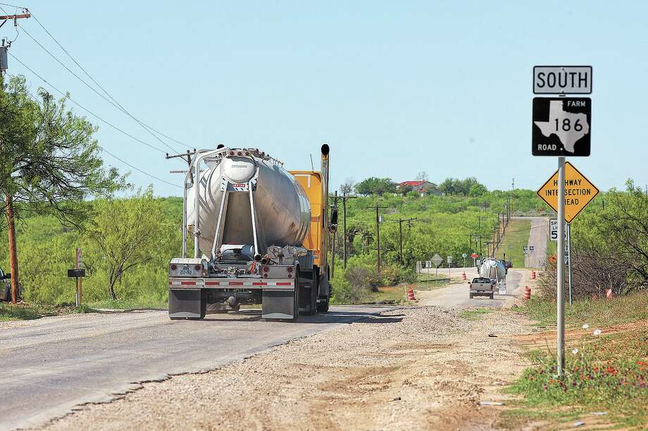 Oilfield-related traffic moves along FM 186 near Carrizo Springs. The Eagle Ford Shale boom is just one of many energy factors boosting the economy, studies say. Photo: JERRY LARA / SAN ANTONIO EXPRESS-NEWS