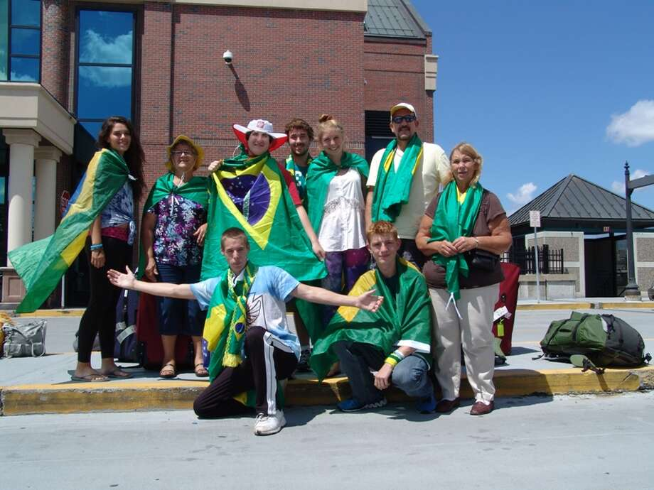Members of the Church of St. John the Evangelist and St. Joseph in Rensselaer, Friday, Aug. 2, 2013, at the Amtrak station, on their return from a 10-day trip to Brazil to participate in the Catholic Church's World Youth Day. Back, l-r: Alyssa Decker, Sandy Raus, Joshua Kenna, John Kenna, Casey Frankoski, John White. Front, l-r: John Repula, Conor Gosh, Linda Remington. (Courtesy Jack Kenna)