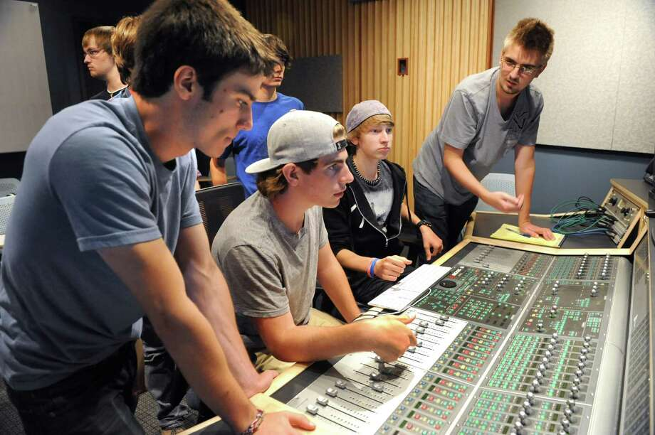 From left, students Chris Petralia, 16, of Alpaus, Reid Perry, 15, of Amsterdam, Nich Jones (cq), 16, of Latham and Patrick Meehan, 20, of Schenectady work the soundboard during an Audio Recording Institute class in the brand new Vianna-Brignola Recording Studio at Schenectady County Community College on Wednesday, July 31, 2013 in Schenectady, N.Y. The studio is part of the new $3.9M SCCC School of Music. (Lori Van Buren / Times Union) Photo: Lori Van Buren / 00023339A