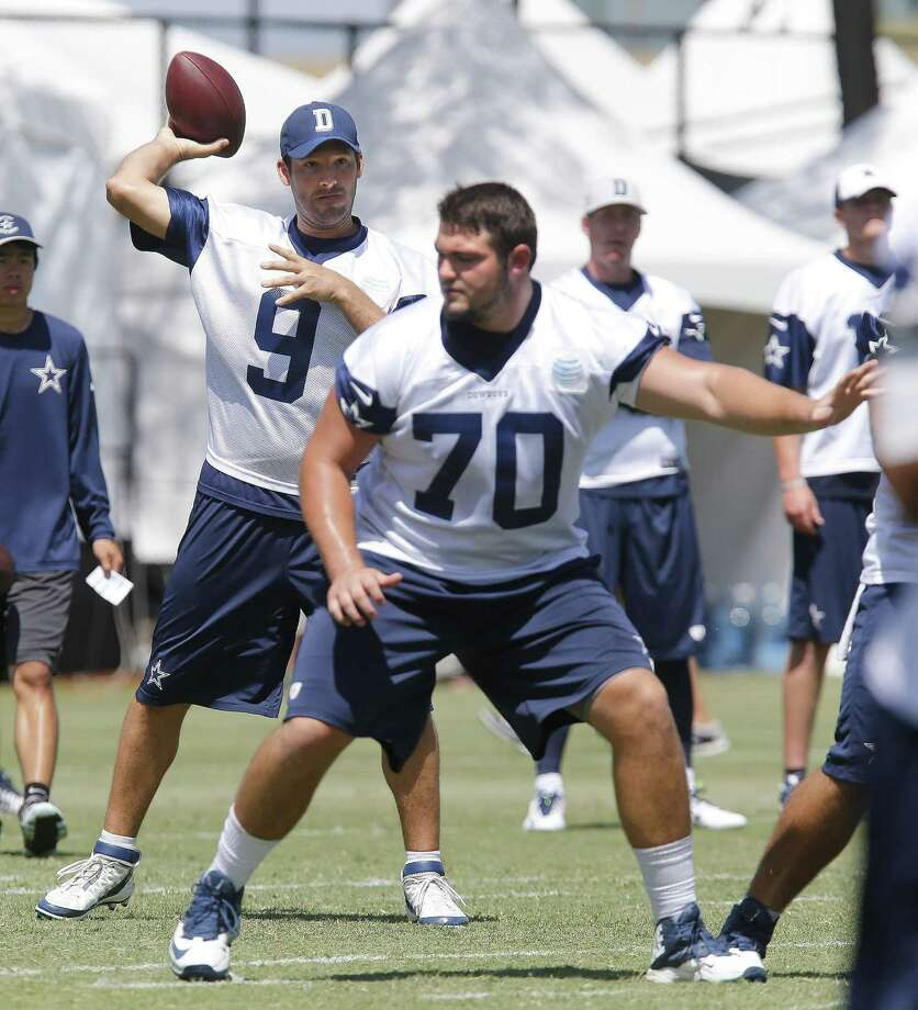 Dallas Cowboys quarterback Tony Romo (9) throws behind rookie offensive lineman Zack Martin during training camp in Oxnard, Calif., on Friday, July 25, 2014. (Ron T. Ennis/Fort Worth Star-Telegram/MCT) Photo: Ron T. Ennis, McClatchy-Tribune News Service / Fort Worth Star-Telegram