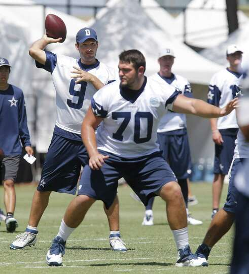 Dallas Cowboys quarterback Tony Romo (9) throws behind rookie offensive lineman Zack Martin during t