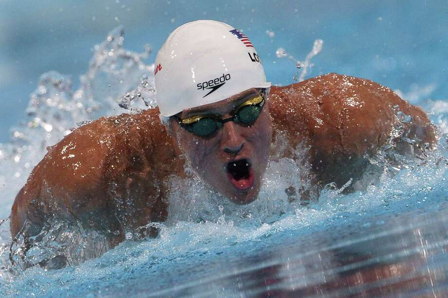 US swimmer Ryan Lochte competes in the heats of the men's 100-metre butterfly swimming event in the FINA World Championships at Palau Sant Jordi in Barcelona on August 2, 2013.   AFP PHOTO / LLUIS GENELLUIS GENE/AFP/Getty Images Photo: LLUIS GENE / AFP