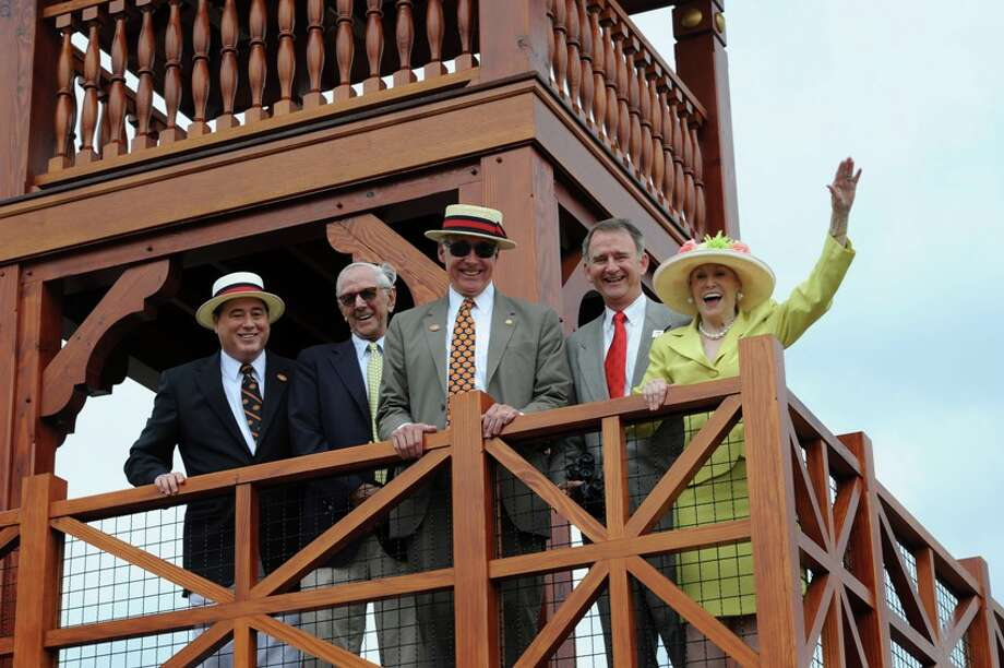 Representatives from the Saratoga 150 Committee and The New York Racing Association, Inc. come together during a ceremonial first viewing atop the Whitney Viewing Stand at Oklahoma Training Track in Saratoga Springs, NY, on Thursday, August 1. From left to right: Saratoga 150 Honorary Chair John Hendrickson; W.C. Whitney's great grandson Lev Miller; Saratoga 150 Chairman Charles Wait; The New York Racing Association, Inc. CEO and President Chris Kay; and Saratoga 150 Honorary Chair Marylou Whitney. (Courtesy NYRA)