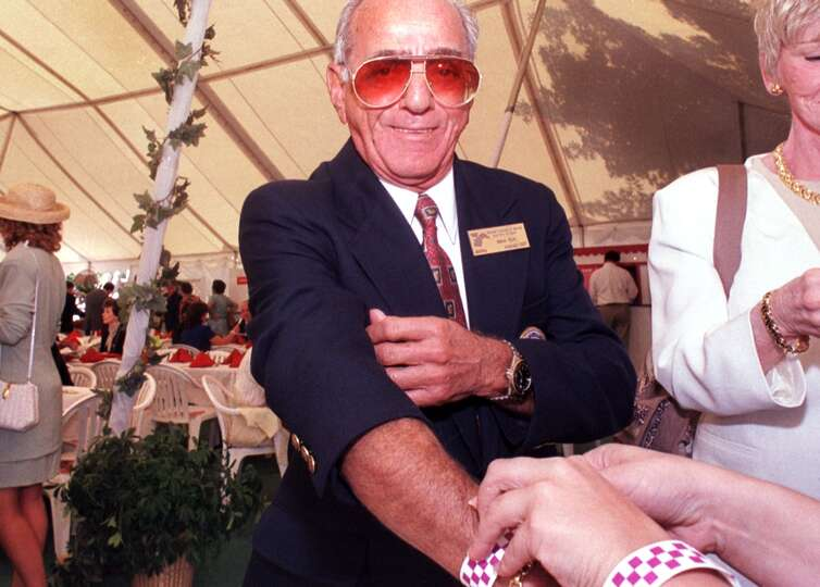 Jockey  Walter Blum has his wrist band attached at the luncheon at the At The Rail Pavilion at the S
