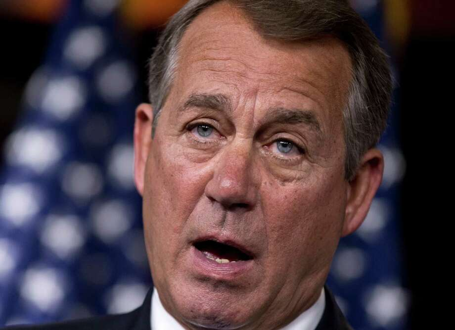 """FILE - In this Aug. 1, 2013 file photo, House Speaker John Boehner of Ohio speaks during a news conference on Capitol Hill in Washington. The accomplishments are few, the chaos plentiful in the 113th Congress, a discourteous model of divided government. """"Have senators sit down and shut up, okay?'' Senate Majority Leader Harry Reid blurted out as lawmakers milled about noisily at a time Sen. Susan Collins was trying to speak. There was political calculation even in that.  Democrats knew the Maine Republican was about rip into her own party's leadership.  (AP Photo/J. Scott Applewhite, File) ORG XMIT: WX203 Photo: J. Scott Applewhite / AP"""