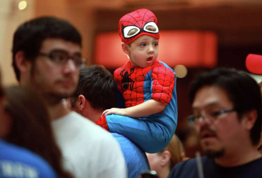 Zane Spoede, 2, reacts to the dressed up crowd at the Space City Con 2013 at the Marriott Westchase on Friday, Aug. 2, 2013, in Houston.  The Space City Con 2013, a family friendly convention, kicks off today and ends Sunday. Photo: Mayra Beltran, Houston Chronicle / © 2013 Houston Chronicle