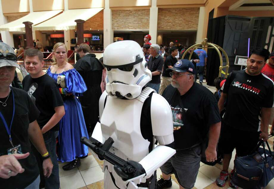 A Storm Trooper walks through the Space City Con 2013 at the Marriott Westchase on Friday, Aug. 2, 2013, in Houston.  The Space City Con 2013, a family friendly convention, kicks off today and ends Sunday. Photo: Mayra Beltran, Houston Chronicle / © 2013 Houston Chronicle