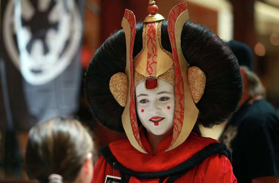 Payton Schmall, 15, dressed at Star Wars 'Queen Amidala', greets visitors in the first day of the Space City Con 2013 at the Marriott Westchase on Friday, Aug. 2, 2013, in Houston.  The Space City Con 2013, a family friendly convention, kicks off today and ends Sunday. Photo: Mayra Beltran, Houston Chronicle / © 2013 Houston Chronicle