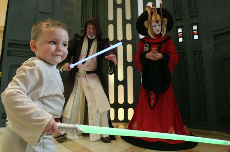 Luke Jackson, 3, dressed as Star Wars 'Luke Skywalker', battles with other characters during the Space City Con 2013 at the Marriott Westchase on Friday, Aug. 2, 2013, in Houston. The Space City Con 2013, a family friendly convention, kicks off today and ends Sunday. Photo: Mayra Beltran, Houston Chronicle / © 2013 Houston Chronicle