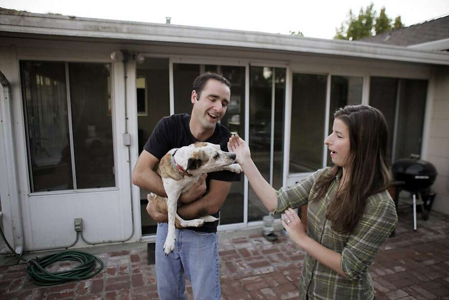 Nick Palmer and Teresa Lasaga with dog Betty at their new San Mateo home that was a pocket listing. Photo: Carlos Avila Gonzalez, The Chronicle