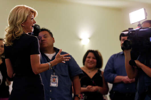 State Senator Wendy Davis, who is running for Texas Governor, answers questions from the media Monday Oct. 7, 2013 at the San Antonio Firefighters Banquet Hall. Photo: Edward A. Ornelas, San Antonio Express-News / © 2012 San Antonio Express-News