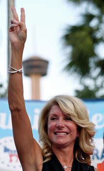 State Senator Wendy Davis, who is running for Texas Governor, answers questions from the media Monday Oct. 7, 2013 at the San Antonio Firefighters Banquet Hall. Photo: Edward A. Ornelas, San Antonio Express-News / © 2013 San Antonio Express-News