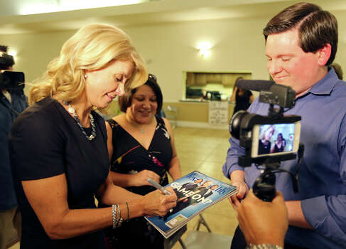 State Senator Wendy Davis, who is running for Texas Governor, autographs a Texas Monthly for Stephen Bachran Monday Oct. 7, 2013 at the San Antonio Firefighters Banquet Hall. Photo: Edward A. Ornelas, San Antonio Express-News / © 2012 San Antonio Express-News