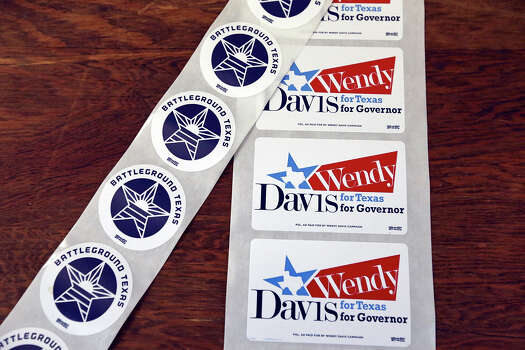 Detail of Wendy Davis for Texas Governor stickers Monday Oct. 7, 2013 at the San Antonio Firefighters Banquet Hall. Photo: Edward A. Ornelas, San Antonio Express-News / © 2012 San Antonio Express-News