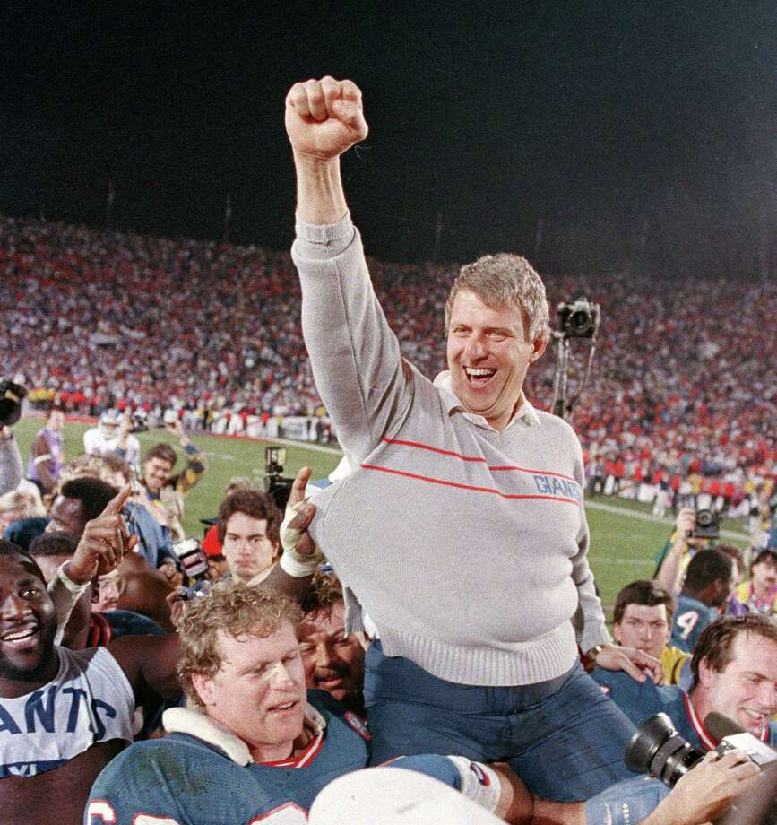 FILE - In this Jan. 25, 1987, file photo, New York Giants coach Bill Parcells is carried off the field after the Giants defeated the Denver Broncos, 39-20, in Super Bowl XXI in Pasadena, Ca. Parcells will enter the Pro Football Hall of Fame in Canton, Ohio, Sunday, Aug. 4, 2013. (AP Photo/Eric Risberg, File) ORG XMIT: NYR104 Photo: Eric Risberg / AP