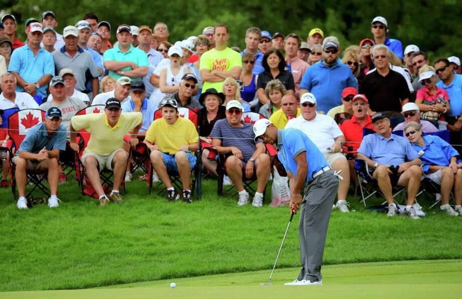 AKRON, OH - AUGUST 02: Tiger Woods putts for birdie on the 12th green during the Second Round of the World Golf Championships-Bridgestone Invitational at Firestone Country Club South Course on August 2, 2013 in Akron, Ohio.  (Photo by Sam Greenwood/Getty Images) ORG XMIT: 160018227 Photo: Sam Greenwood / 2013 Getty Images
