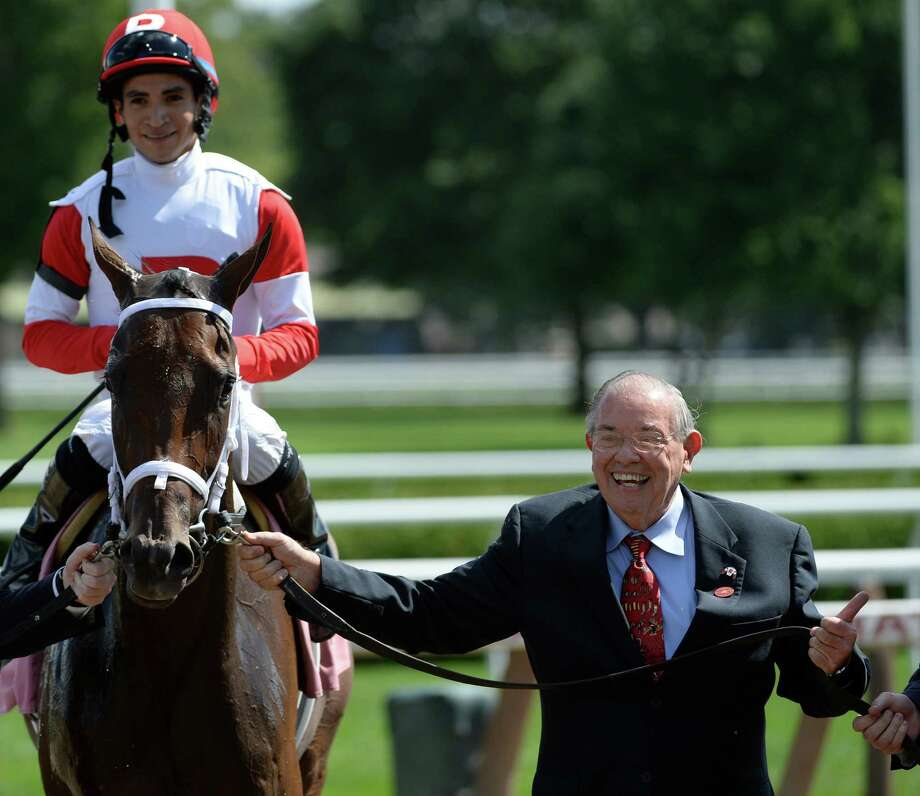Owner Ken Ramsey is jubilant after winning the 5th race with Saturday Nthe Park Friday, Aug. 2, 2013, at Saratoga Race Course in Saratoga Springs, N.Y.  Jockey Alan Garcia, left, was aboard for the win. (Skip Dickstein/Times Union) Photo: SKIP DICKSTEIN