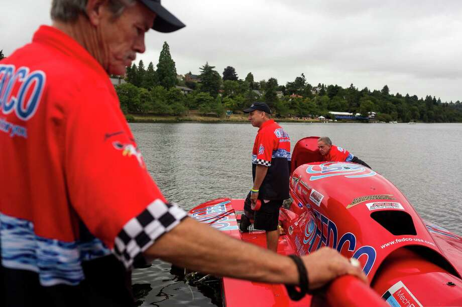 The FEDCO pit team prepares to push their boat out for a time trial on the first day of the Albert Lee Appliance Cup at Seafair Friday, August 2, 2013, in Seattle. The hydroplanes, air shows and live music continues through Sunday. Photo: JORDAN STEAD, SEATTLEPI.COM / SEATTLEPI.COM