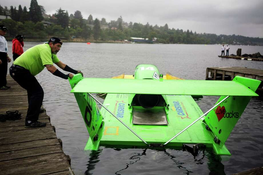 The Miss DiJulio hydroplane is pushed away from the pits for a time trial run on the first day of the Albert Lee Appliance Cup at Seafair Friday, August 2, 2013, in Seattle. The hydroplanes, air shows and live music continues through Sunday. Photo: JORDAN STEAD, SEATTLEPI.COM / SEATTLEPI.COM