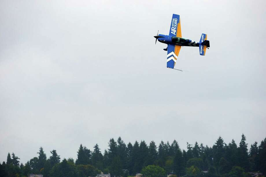 A member of the Air National Guard Aerobatic Team performs stunts on the first day of the Albert Lee Appliance Cup at Seafair Friday, August 2, 2013, in Seattle. The hydroplanes, air shows and live music continues through Sunday. Photo: JORDAN STEAD, SEATTLEPI.COM / SEATTLEPI.COM