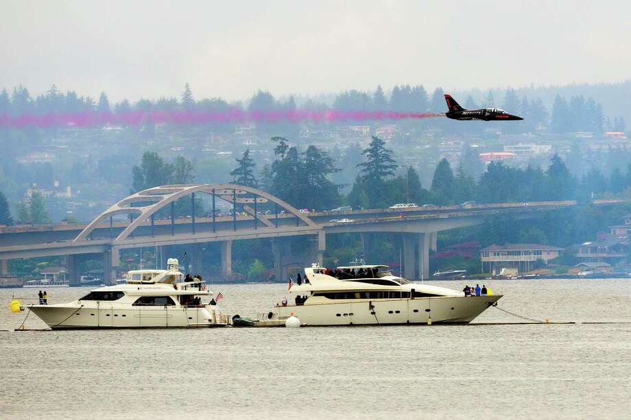 The Patriots Jet Team perform in place of the Blue Angels on the first day of the Albert Lee Appliance Cup at Seafair Friday, August 2, 2013, in Seattle. The hydroplanes, air shows and live music continues through Sunday. Photo: JORDAN STEAD, SEATTLEPI.COM / SEATTLEPI.COM