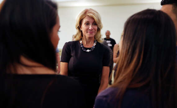 State Senator Wendy Davis, who is running for Texas Governor, greets volunteers Monday Oct. 7, 2013 at the San Antonio Firefighters Banquet Hall. Photo: Edward A. Ornelas, San Antonio Express-News / © 2012 San Antonio Express-News