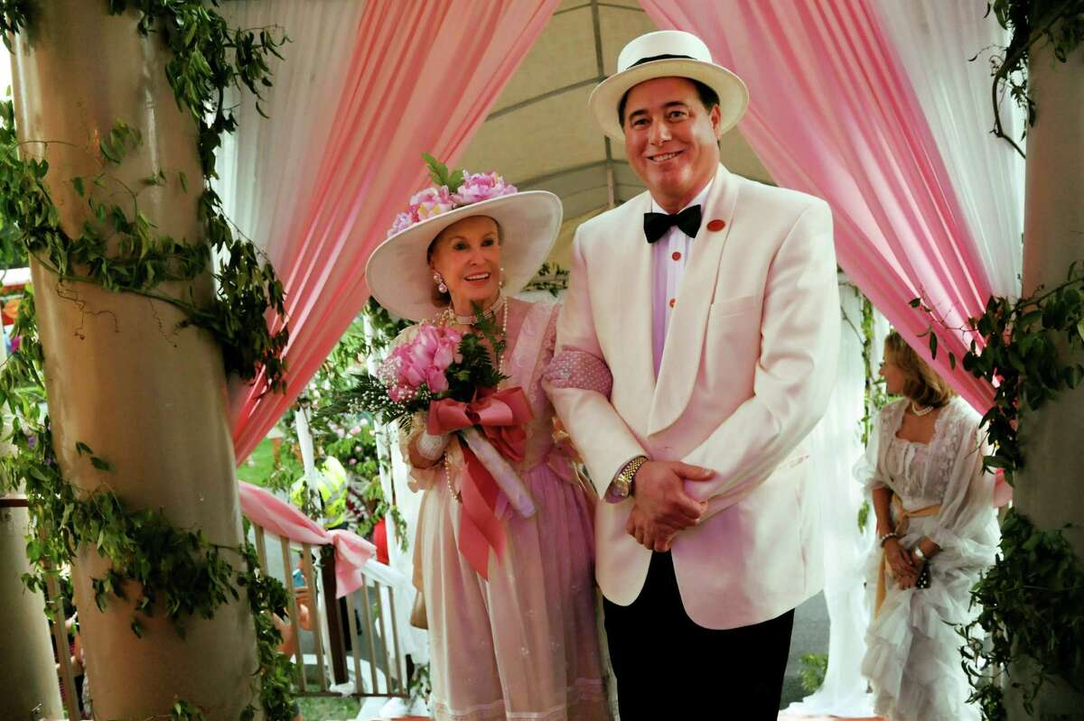 Marylou Whitney, left, and her husband John Hendrickson arrive at the Canfield Casino following an Old Fashioned Floral Fete Promenade to celebrate 150 years of thoroughbred racing on Friday, Aug. 2, 2013, in Saratoga Springs, N.Y. (Cindy Schultz / Times Union)