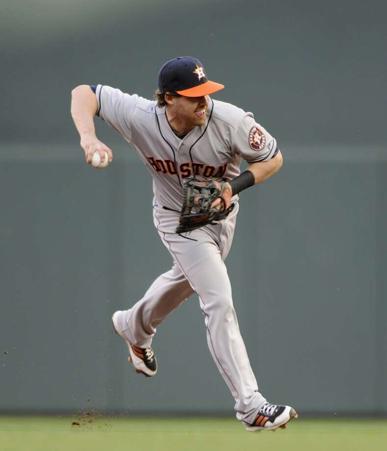 August 2: Twins 4, Astros 3 (13)Jake Elmore makes a play to get Joe Mauer out at first. Photo: Hannah Foslien, Getty Images