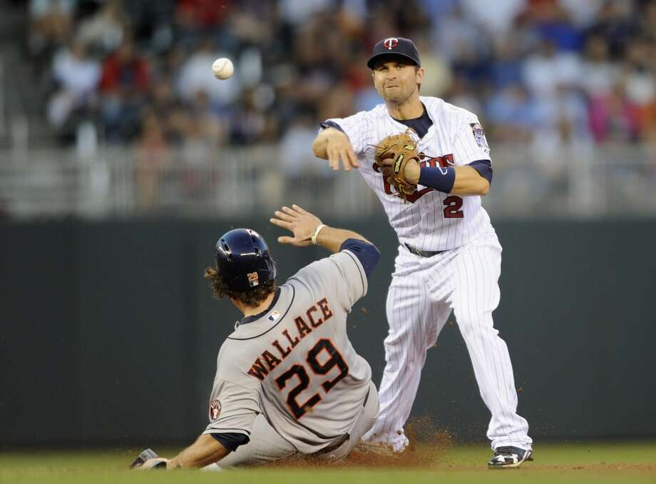 Brett Wallace is out at second as Brian Dozier turns a double play. Photo: Hannah Foslien, Getty Images