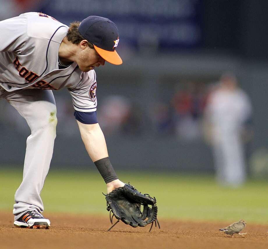 Jake Elmore tries to get a bird to move along  during  a break in action. Photo: ANDY KING, Associated Press